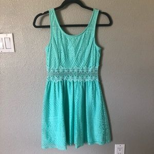 Turquoise lace dress.